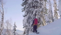 Skitour in Siberia. A man climbing up the hill in a snowy forest. 48039436
