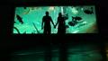 Romantic couple come together in oceanarium holding hands 48041808