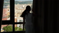 Woman open curtains on window and look on modern cityscape, Barcelona 48060981