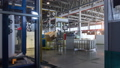 timelapse worker loads plastic tanks into production line 48109589