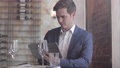 Businessman using a digital tablet in a restaurant 48159674
