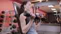 Strong woman working out with dumbbells 48160823