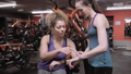 Friends comparing fitness trackers at the gym 48160825