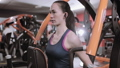Strong woman working out on weight machine  48160834