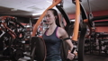 Strong woman working out on weight machine  48160835