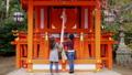 Girls praying at shinto shrine in Kyoto Japan. 48202535