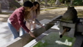 Two female friends washing hands at Kyoto temple. 48312924