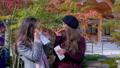 International tourists enjoying street food, Kyoto 48314513