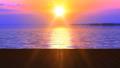 Fabulous lake under pink sky during sunset 48386379