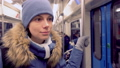 Woman rides in a subway car in winter clothes. Daily life of a city dweller. 48436153