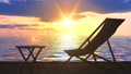 Deck chair and table with glass of wine at ocean coast 48450425