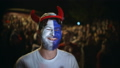 Person with the paint on face jump in delight from victory of the match 48464746