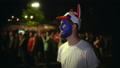 Person with paint face enthusiastically watche football match background crowd 48466259