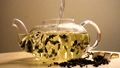 Water pouring in teapot with green tea 48474229