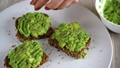Spreading mashed avocado on toast and sprinkle with salt and spices. Healthy vegan breakfast. 48487229