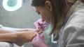 Professional cosmetologist doing manicure on female barefeet. 48488380