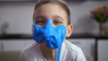 Adorable funny boy with face covered blue slime 48524565