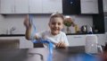 Smiling boy playing with long handmade slime 48524567