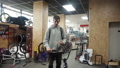 Man at the sports store explains something and laugh 48547795