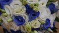 Bride's bouquet of beautiful flowers, groom's boutonniere, wedding day 48590519
