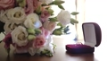 Bride's bouquet of beautiful flowers, groom's boutonniere, wedding day 48590581