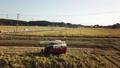 稲刈り コンバインを運転する男性 イメージ ドローン撮影 48624106