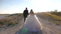 teamwork of couple in love. happy bride in a beautiful white dress with groom run behind city hand 48647121