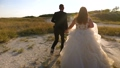 loving couple runs down the road holding hands. Bride and groom happy family concept. newlyweds 48647122