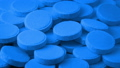 Pile Of Blue Medical Tablets Rotating 48683127