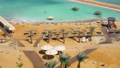Aerial view of Dead Sea resort. Hotel beach from above with unrecognizable people walking around 48688607