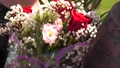 flowers as a gift for the holiday. bouquet in the hands of a woman of beautiful flowers and red 48715042