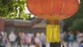 Red lantern waving in Beijing by day 48735349