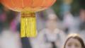 Red lantern waving in Beijing by day 48735354