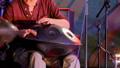 Unrecognizable man playing hang drum 48735752