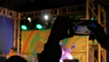 Hands silhouette recording video of live music concert with smartphone 48735776