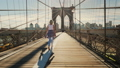 Active young woman walks on the Brooklyn Bridge in New York 48743887