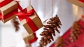 Hanging presents and pine cones 48762771