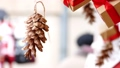 Hanging pine cone and presents 48762775