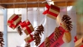 Hanging presents and pine cones 48762776