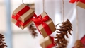 Hanging presents and pine cones 48762777