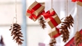 Hanging presents and pine cones 48762778