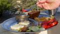 Man eating Indian food dockla and chutney 48765044