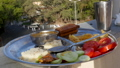 Man eating Indian food dockla and chutney 48765045