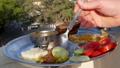 Man eating Indian food dockla and chutney 48765046