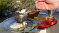 Man eating Indian food dockla and chutney 48765047