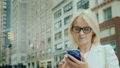 Attractive woman using smartphone in downtown New York 48773309