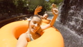 Happy Couple Having Fun in Waterpark. Young Mixed Race Girl Making Selfie and Waving Hands to Camera 48776613