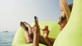 Attractive Young Happy Woman Using Smartphone on Floating Inflatable Mattress at Tropical Beach 48776647