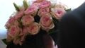 bouquet of multicolored roses in hands of a man. 48780821