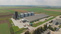 Aerial view of agriculture grain silos storage tanks. FullHD 48800156